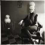 Фотография | Diane Arbus | Lady bartender at home with a souvenir dog