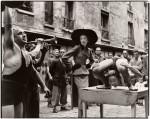 Фотография | Richard Avedon | Elise Daniels with street performers, suit by Balenciaga, Paris, August 1948